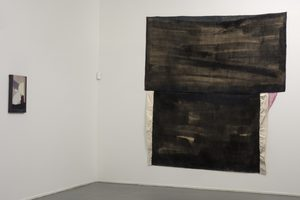 Black sewn image. Installation shot with painting, Miami